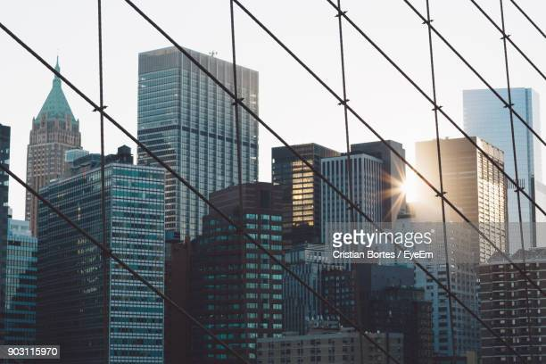 low angle view of office building against sky in city - bortes stockfoto's en -beelden