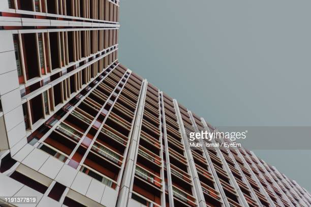 low angle view of office building against sky - nigeria stock pictures, royalty-free photos & images
