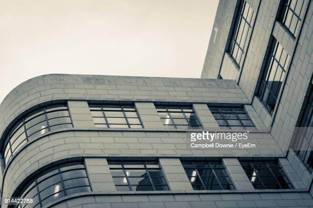 low angle view of office building against sky - campbell downie stock pictures, royalty-free photos & images