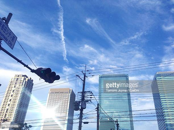 Low Angle View Of Office Skyscrapers At Umeda Against Sky