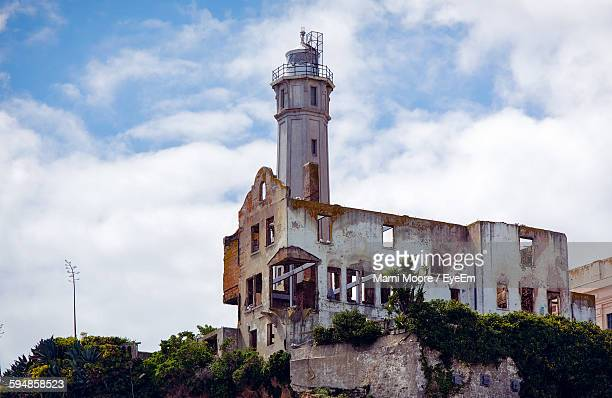 low angle view of old abandoned prison building at alcatraz island against sky - alcatraz stock photos and pictures