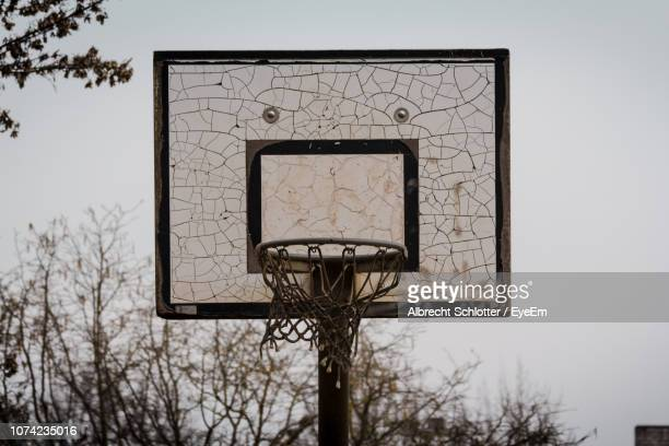 low angle view of old basketball hoop against clear sky - albrecht schlotter fotografías e imágenes de stock
