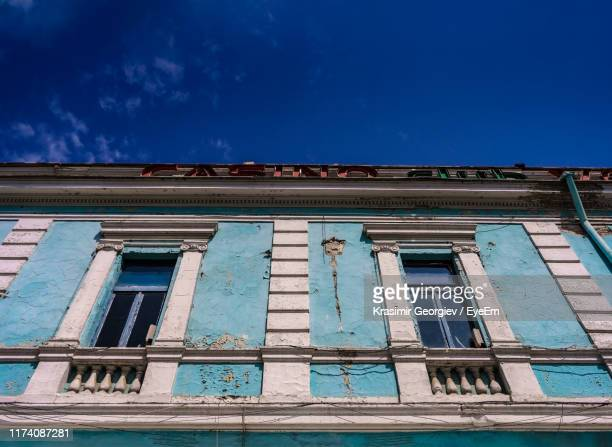 low angle view of old building against blue sky - krasimir georgiev stock photos and pictures
