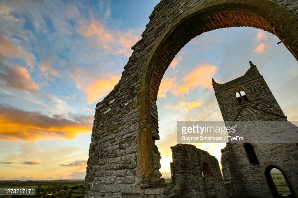 low angle view of old building against sky during sunset - taunton somerset stock pictures, royalty-free photos & images