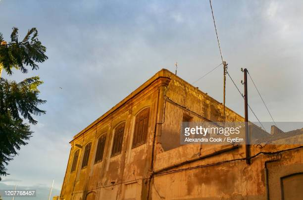 low angle view of old building against sky - alexandra valencia stock-fotos und bilder