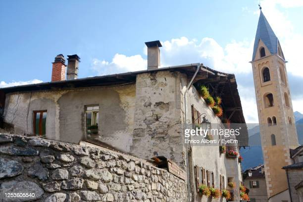 low angle view of old building against sky - enrico aliberti stock-fotos und bilder