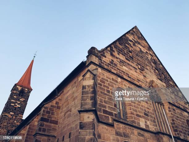 low angle view of old building against sky - data topuria stock pictures, royalty-free photos & images