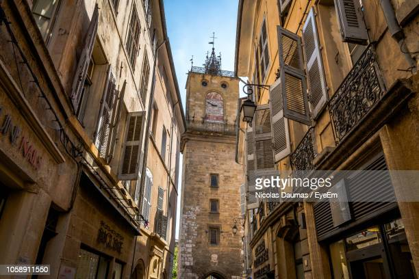 low angle view of old building in city - aix en provence stock pictures, royalty-free photos & images