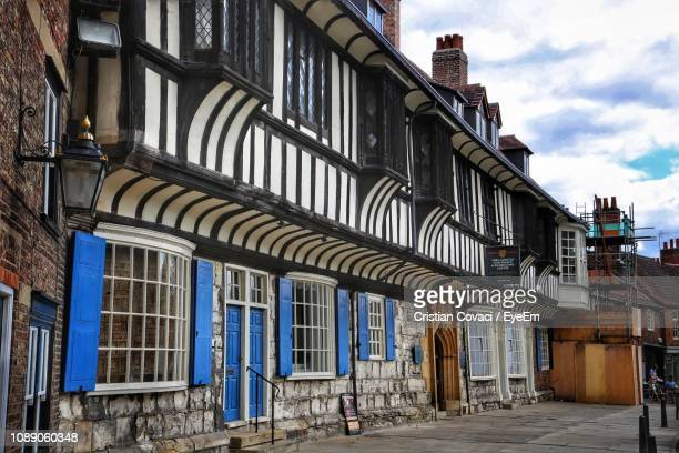 low angle view of old building in city - york yorkshire stock pictures, royalty-free photos & images