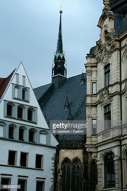 low angle view of old buildings against sky - lowitsch stock-fotos und bilder