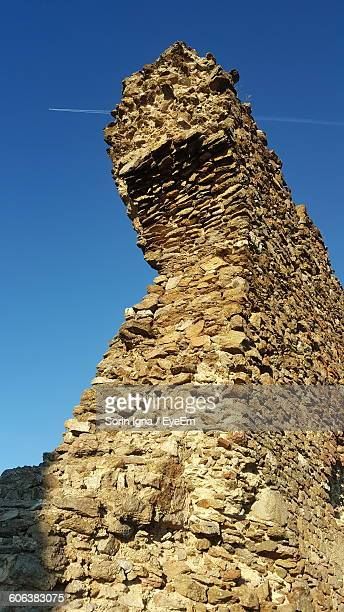 Low Angle View Of Old Built Structure Against Clear Blue Sky