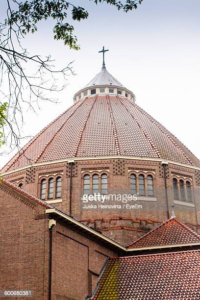 low angle view of old church against sky - heinovirta stock pictures, royalty-free photos & images