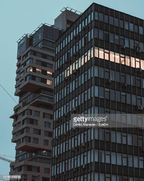 low angle view of old modern buildings against clear sky - former soviet union stock pictures, royalty-free photos & images