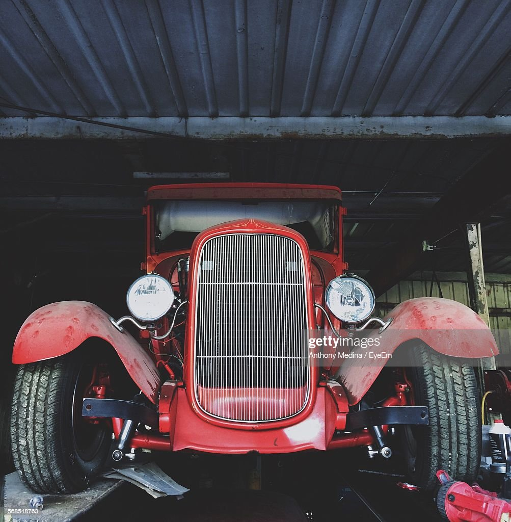 Low Angle View Of Old Red Vintage Car : Stock Photo