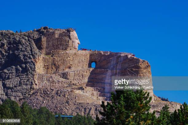low angle view of old ruin against clear blue sky - black hills stock photos and pictures