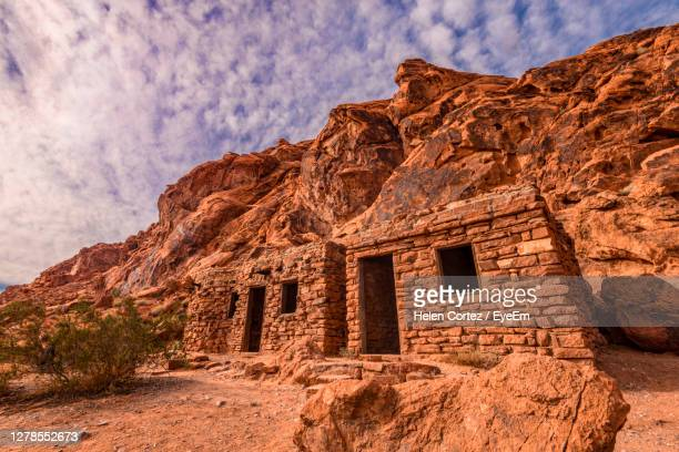 low angle view of old ruin building against cloudy sky at valley of fire - valley of fire state park stock pictures, royalty-free photos & images
