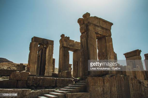 low angle view of old ruins against clear blue sky - tehran stock pictures, royalty-free photos & images