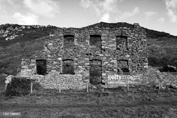 low angle view of old ruins against sky - llandudno wales stock pictures, royalty-free photos & images