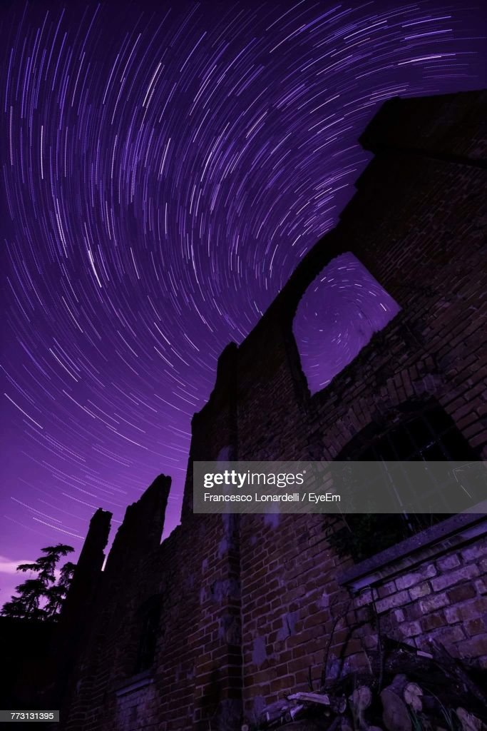 Low Angle View Of Old Ruins Against Star Trail : Photo
