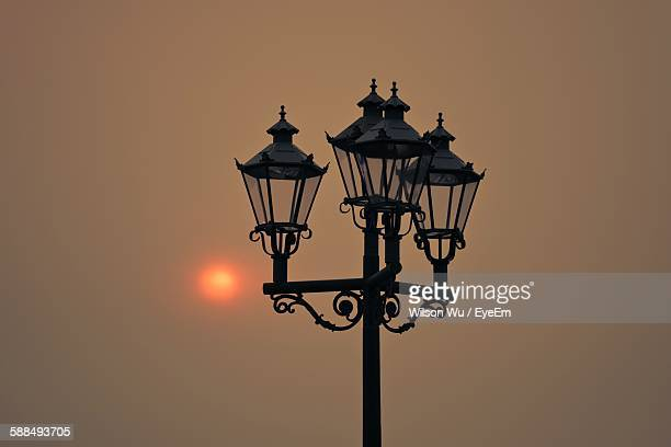 low angle view of old street light against clear sky during sunset - ガス燈 ストックフォトと画像