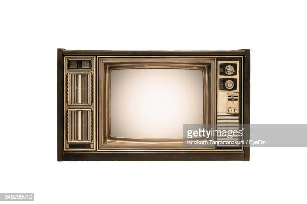 Low Angle View Of Old Television Set Against White Background