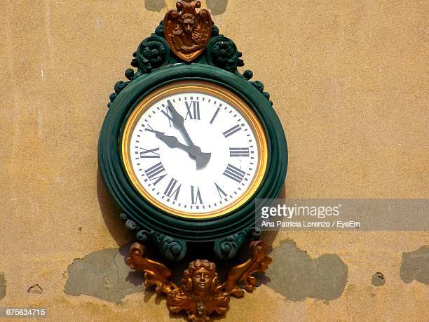 Low Angle View Of Old Wall Clock