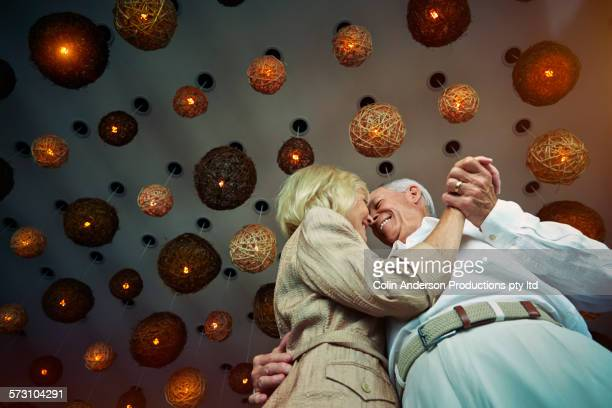 Low angle view of older Caucasian couple dancing