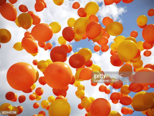 Low angle view of orange and yellow balloon