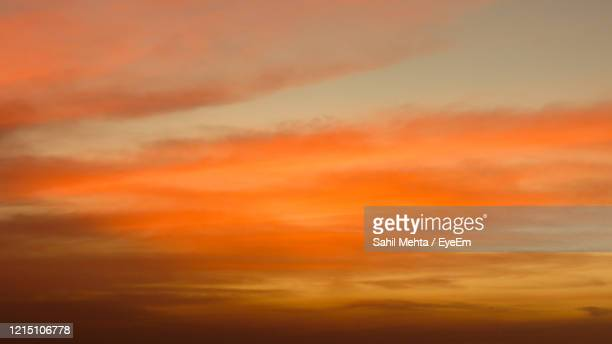 low angle view of orange sky - romantic sunset stock pictures, royalty-free photos & images