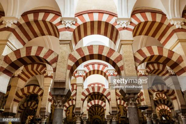 Low angle view of ornate arches in mosque, Cordoba, Andalusia, Spain