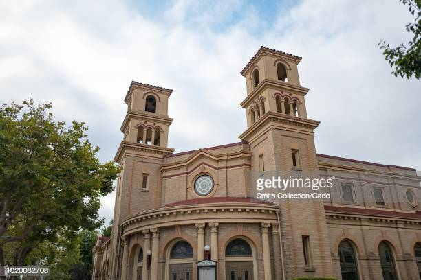 Low angle view of ornate architecture of the Twins Towers Methodist Church a historic church on Alameda Island Alameda California August 13 2018