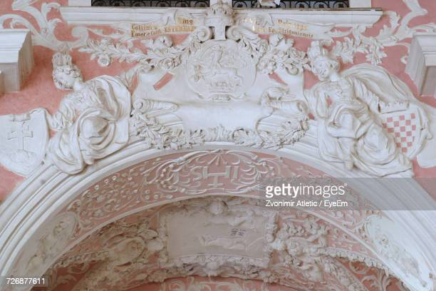 Low Angle View Of Ornate Carvings On Wall