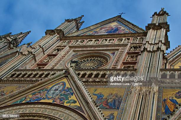 low angle view of orvieto cathedral - orvieto stock pictures, royalty-free photos & images