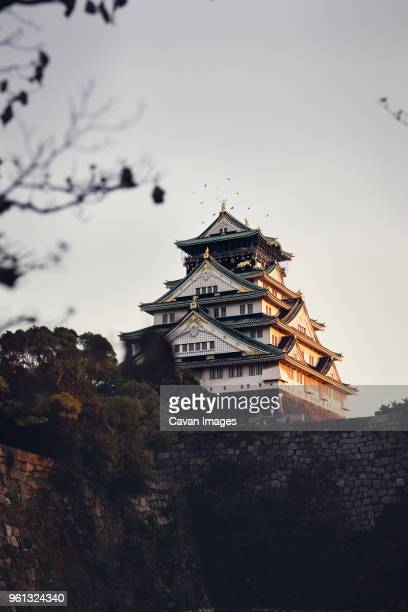 Low angle view of Osaka castle against clear sky during sunset