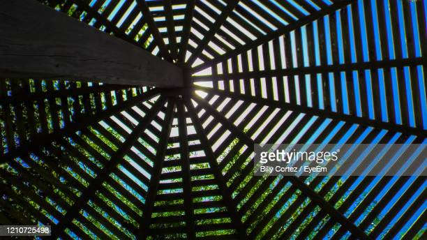 low angle view of outdoor wood ceiling against sky - south padre island stock pictures, royalty-free photos & images
