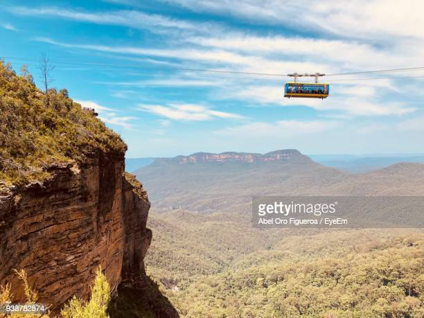 low angle view of overhead cable car against mountains - katoomba stock pictures, royalty-free photos & images