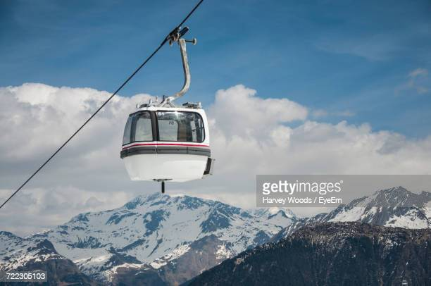 low angle view of overhead cable car against sky - cable car stock pictures, royalty-free photos & images