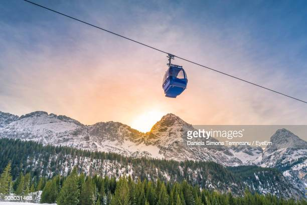 low angle view of overhead cable car against sky - overhead cable car stock pictures, royalty-free photos & images