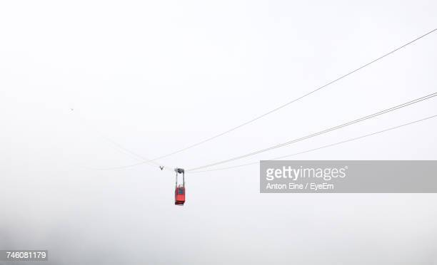 Low Angle View Of Overhead Cable Car During Foggy Weather