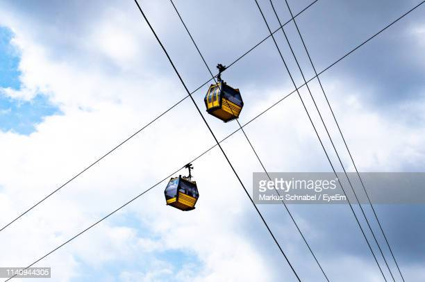 low angle view of overhead cable cars against sky - ankara turkey stock pictures, royalty-free photos & images