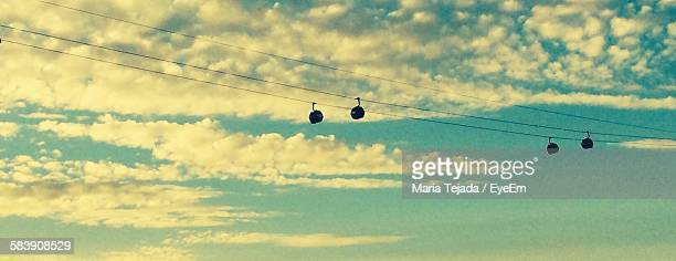 low angle view of overhead cable cars against sky - maria tejada stock pictures, royalty-free photos & images