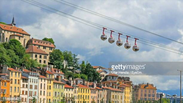 low angle view of overhead cable cars in city against sky - grenoble stockfoto's en -beelden
