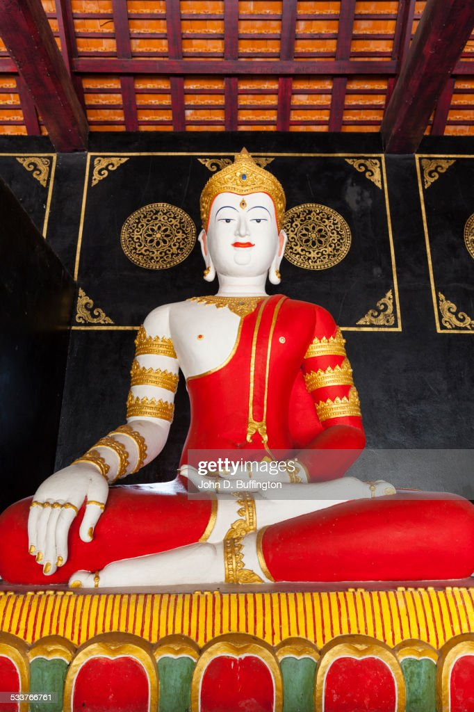 Low angle view of painted Buddha statue in temple : Foto stock