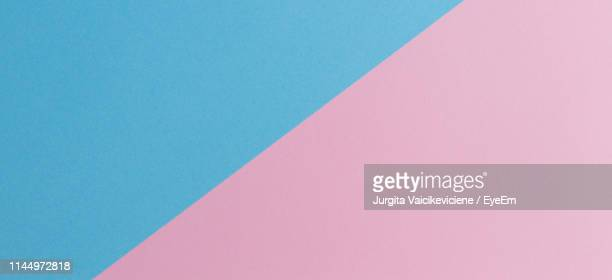 low angle view of paper against clear blue sky - pink and blue background stock pictures, royalty-free photos & images