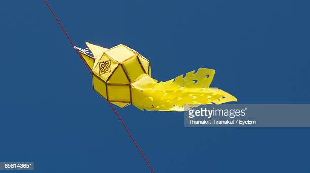 Low Angle View Of Paper Lantern Hanging Against Clear Sky