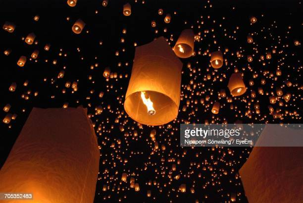low angle view of paper lanterns at night - chinese lantern festival stock pictures, royalty-free photos & images