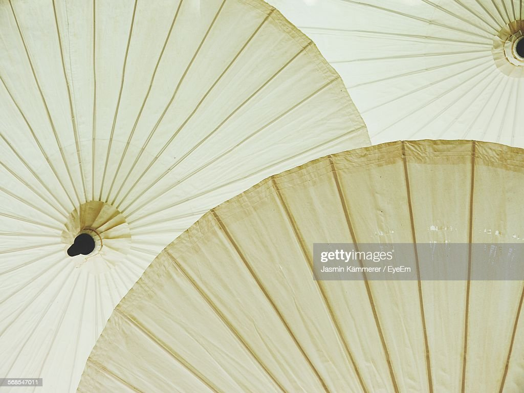Low Angle View Of Paper Umbrellas : Stock Photo