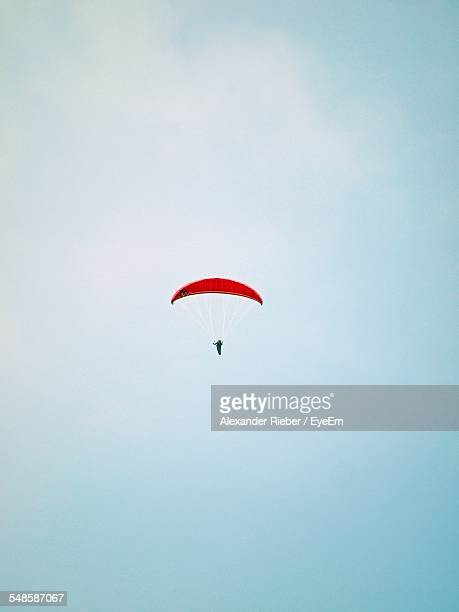 Low Angle View Of Parachutist Against Clear Sky