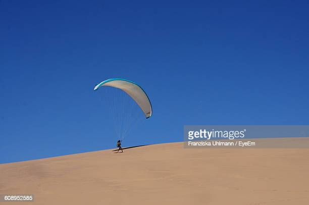 Low Angle View Of Paraglider On Desert