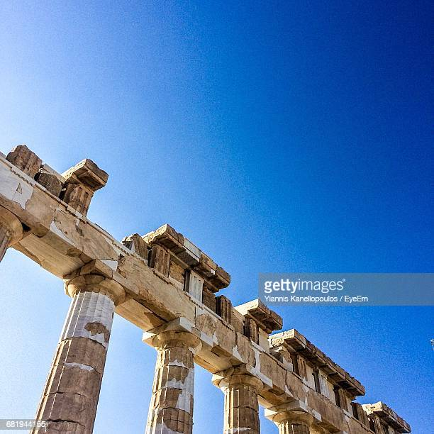 Low Angle View Of Parthenon Columns Against Clear Blue Sky